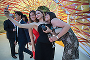 SELFIE; ALINA USPENSKAYA; ANIA SMORODSKAYA; EKATERINA KASHYNTSEVA, Serpentine's Summer party co-hosted with Christopher Kane. 15th Serpentine Pavilion designed by Spanish architects Selgascano. Kensington Gardens. London. 2 July 2015.