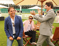 Left, JAMIE REUBEN at the Cartier International Polo at Guards Polo Club, Windsor Great Park, Berkshire on 25th July 2010.