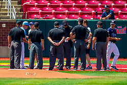 25 May 2019:  Umpires and coaches meet at the plate prior to the game for introductions and line up card exchange. Missouri Valley Conference Baseball Tournament - Dallas Baptist Patriots v Indiana State Sycamores at Duffy Bass Field in Normal IL<br /> <br /> #MVCSPORTS