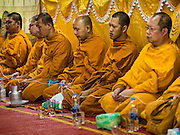 "21 DECEMBER 2015 - BANGKOK, THAILAND:  Buddhist monks lead prayers during the annual rededication of a Buddhist shrine in Pak Khlong Talat, also called the Flower Market. The market has been a Bangkok landmark for more than 50 years and is the largest wholesale flower market in Bangkok. A recent renovation resulted in many stalls being closed to make room for chain restaurants to attract tourists. Now Bangkok city officials are threatening to evict sidewalk vendors who line the outside of the market. Evicting the sidewalk vendors is a part of a citywide effort to ""clean up"" Bangkok.      PHOTO BY JACK KURTZ"