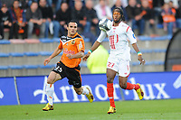 FOOTBALL - FRENCH CHAMPIONSHIP 2009/2010 - L1 - FC LORIENT v LILLE OSC - 15/05/2010 - PHOTO PASCAL ALLEE / DPPI -  KOUASSI GERVAIS YAO GERVIHNO (LILLE) / JEREMY MOREL (FCL)