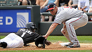 CHICAGO - JULY 10:  Michael Cuddyer #5 of the Minnesota Twins catches the ball as Juan Pierre #1 of the Chicago White Sox dives safely back to first base during the game against the Chicago White Sox on July 10, 2011 at U.S. Cellular Field in Chicago, Illinois.  The Twins defeated the White Sox 6-3.  (Photo by Ron Vesely)  Subject: Michael Cuddyer;Juan Pierre