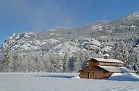 Methow Valley Washington farm with barn in winter