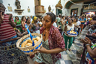 The rite of bread, in the African ballad and sung mass, every Tuesday afternoon in the church of Nossa Senhora do Rosario dos Pretos, in Largo Pelourinho
