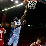 Anadolu Efes's Stephane Lasme (C) during their Turkish Basketball League match Anadolu Efes between Ted Kolej at Abdi Ipekci Arena in Istanbul Turkey on Monday 16 March 2015. Photo by Aykut AKICI/TURKPIX
