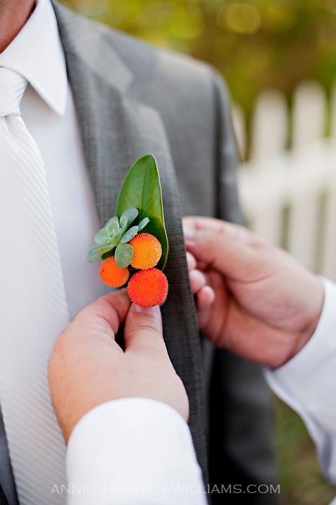 A groom's boutineer is pinned on his lapel at the Coloma Country Inn in Coloma, California.