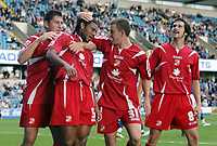 Photo: Rich Eaton.<br /> <br /> Millwall v Swindon Town. Coca Cola League 1. 29/09/2007. Swindon's Jerel Ifil (2nd L) celebrates with fellow goalscorer Simon Cox (2nd R) after heading in a second half goal to make it 2-1.