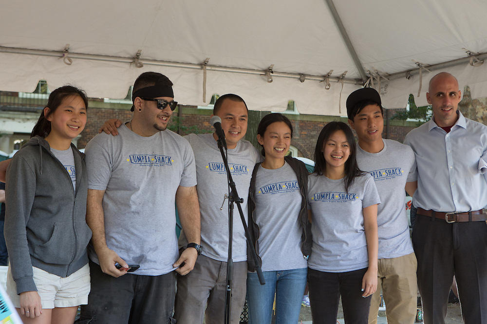 Lumpia Shack employees pose for photos after accepting the award for Best of the Market Vendors. On the right is Sean Basinski, director of the Street Vendor Project, which sponsors the event.