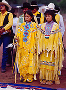 Carla and Carmin Goseyun facing east with the Burnette Singers, Carla Goseyun's White Mountain Apache Traditional Sunrise Ceremony, Whiteriver, Arizona.  Please Note: A small extra licensing fee needs to be paid to the Goseyun Family for usage of this photo. Contact Fred Hirschmann for more information. Thanks.