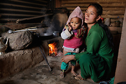 Niruta dresses her youngest child, 11-month-old Kusum, at home. <br /> <br /> Niruta and Durga were married 9 years ago, when they were just 14 and 16 years old in the Kagati village of Nepal. The 2015 earthquakes devastated Nepal and left girls and women in an increasingly vulnerable position, leading experts to believe child marriage rates will increase over the coming years.