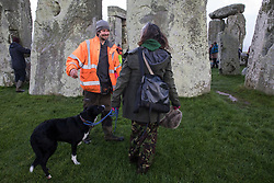 Dan Hooper, better known as roads protester Swampy in the 1990s, joins over one hundred people, including local residents, climate and land justice activists and pagans, at a Mass Trespass at Stonehenge on 5 December 2020 in Salisbury, United Kingdom. The trespass was organised in protest against the approval by Transport Secretary Grant Shapps of a £1.7bn project for a two-mile tunnel beneath the World Heritage Site and a further eight miles of dual carriageway for the A303, as well as the government's £27bn Road Investment Strategy 2 (RIS2).