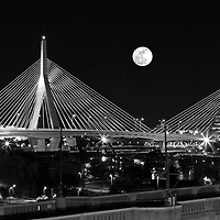 Black and White New England nature and astrology photography of a rising full moon over the historic Boston Bunker Hill Bridge in Charlestown, MA. This iconic bridge is better known as the Zakim Bridge that was erected as part of the Big Dig. It is always a special treat experiencing and photographing a full moon.<br /> <br /> Super moon is the next step up and the next one is expected 14 November 2016. A supermoon is known as a new or full moon occurring at the same time the moon comes within 90 percent of its closest approach to Earth in a given orbit. It is an astronomical event that happens 4-6 times a year, but according to a NASA Science News story, last nights full moon nearly coincided with the moon's arrival at its closest point in its orbit around the Earth, resulting in the biggest, visible full moon in North America in two decades. Next super moon to watch November 14, 2016 ... mark your calendars.<br /> <br /> B&W Boston full moon photos are available as museum quality photography prints, canvas prints, acrylic prints or metal prints. Fine art prints may be framed and matted to the individual liking and decorating needs:<br /> <br /> http://juergen-roth.pixels.com/featured/full-moon-rising-over-boston-zakim-bridge-juergen-roth.html<br /> <br /> All Black and White Boston landmark photos are available for digital and print image licensing at www.RothGalleries.com. Please contact me direct with any questions or request.<br /> <br /> Good light and happy photo making!<br /> <br /> My best,<br /> <br /> Juergen<br /> Prints: http://www.rothgalleries.com<br /> Photo Blog: http://whereintheworldisjuergen.blogspot.com<br /> Instagram: https://www.instagram.com/rothgalleries<br /> Twitter: https://twitter.com/naturefineart<br /> Facebook: https://www.facebook.com/naturefineart