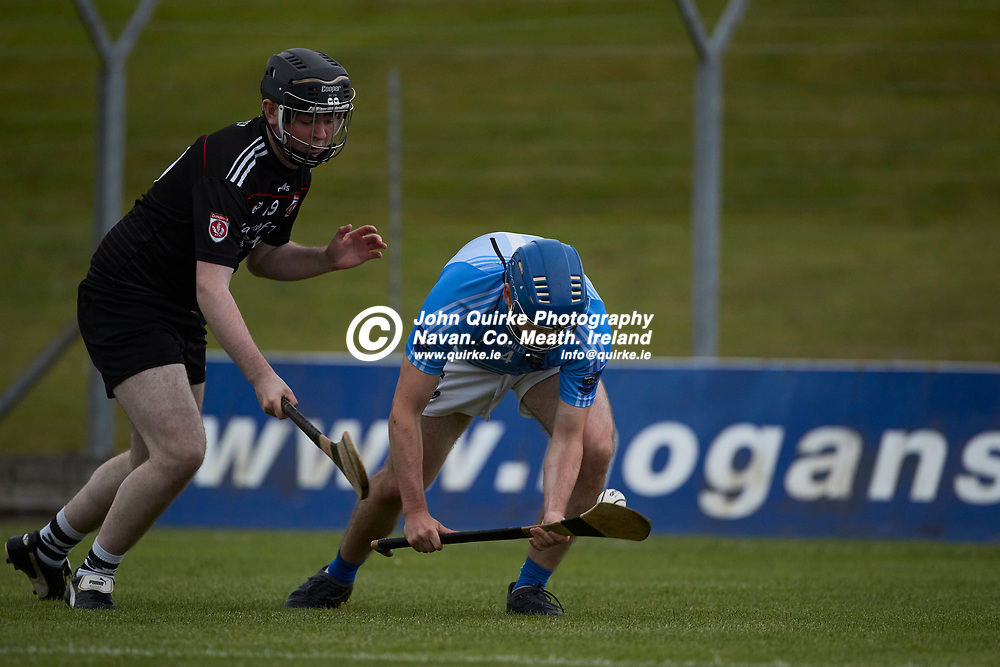 06-08-21, <br /> J2HC 2020 Final at Pairc Tailteann, Navan.<br /> Boardsmill v Dunderry<br /> Sean Newman (Boardsmill) & 19 (Dunderry)<br /> Photo: David Mullen / www.quirke.ie ©John Quirke Photography, Proudstown Road Navan. Co. Meath. 046-9079044 / 087-2579454.<br /> ISO: 640; Shutter: 1/1250; Aperture: 4;