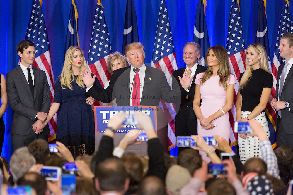 Billionaire and GOP presidential candidate Donald Trump addresses supporters along with his family and Lt. Gov. Henry McMasters during victory celebrations following their win in the South Carolina Republican primary February 20, 2016 in Spartanburg, South Carolina, USA .