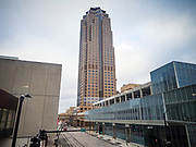 """20 MARCH 2020 - DES MOINES, IOWA: 801 Grand, the tallest office tower in Iowa, is closed Friday. The building is a part of the campus of Principal, a large financial services company. The building was shutdown Friday after a visitor tested positive for COVID-19. Some workers were placed in self quarantine and all were ordered to work from home. On Friday morning, 20 March, Iowa reported 45 confirmed cases of the Coronavirus. Restaurants, bars, movie theaters, places that draw crowds are closed for at least 30 days. There are no """"shelter in place"""" orders in effect anywhere in Iowa but people are being encouraged to practice """"social distancing"""" and many businesses are requiring or encouraging employees to telecommute.       PHOTO BY JACK KURTZ"""
