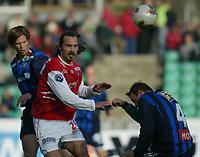 Fotball. Tippeligaen. 01.05.2002.<br /> Stabæk v Bryne 2-1.<br /> Dejan Pavlovic, Bryne.<br /> Mike Kjølø (4) og Andre Muri, Stabæk.<br /> Foto: Morten Olsen, Digitalsport