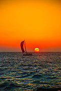 Sailboat at sunset in the Mediterranean Sea