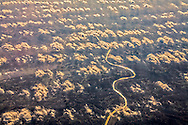 River and clouds below