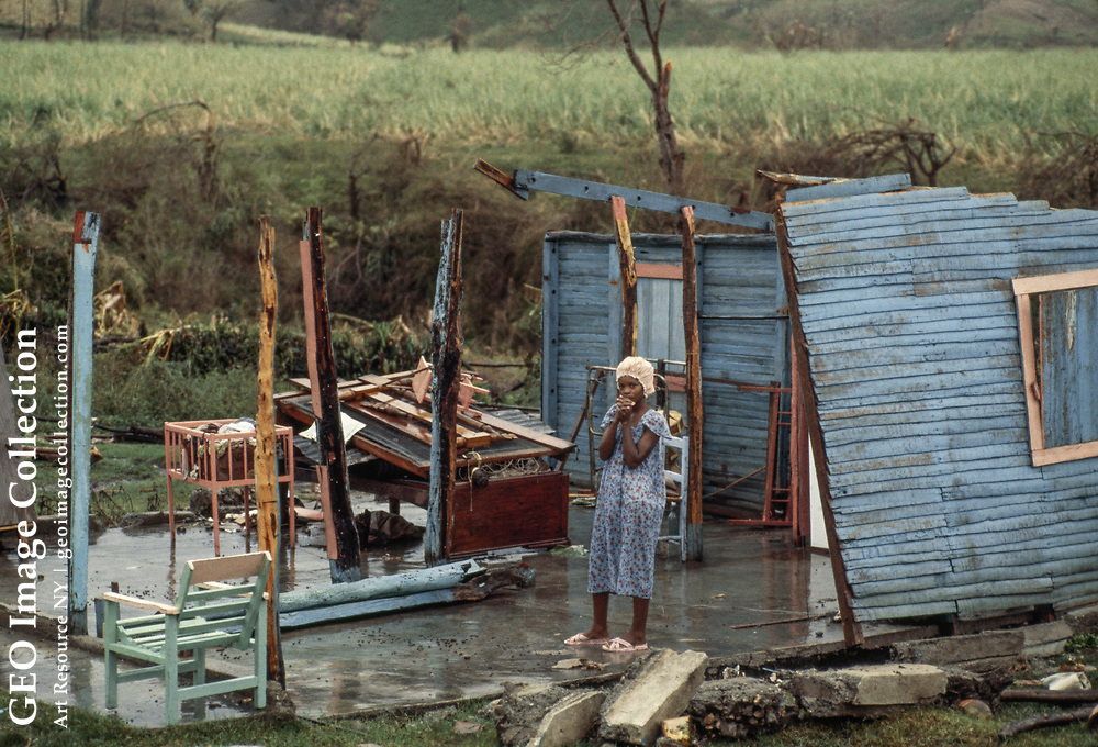 A sugarcane cutter stands in the ruins of Hurricane David. Hurricane David was an extremely deadly hurricane which caused massive loss of life in the Dominican Republic in August 1979, and was the most intense hurricane to make landfall in the country in recorded history., killing over 2000 people.