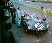 Whitsun Sports car race 3 June 1963, Pat Coundley in car John Coundley standing,  Jaguar D-type, Goodwood, England, UK