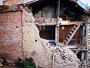 14 MARCH 2017 - BUNGAMATI, NEPAL: A home damaged and ripped open during the 2015 earthquake in Bungamati. Recovery seems to have barely begun nearly two years after the earthquake of 25 April 2015 that devastated Nepal. In some villages in the Kathmandu valley workers are working by hand to remove ruble and dig out destroyed buildings. About 9,000 people were killed and another 22,000 injured by the earthquake. The epicenter of the earthquake was east of the Gorka district.            PHOTO BY JACK KURTZ