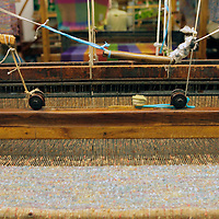 Europe, Ireland, Avoca. Avoca Handweavers Mill, County Wicklow. Woollen Loom and spindle.