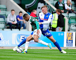 Plymouth Argyle's Durrell Berry is tackled by Bristol Rovers' Ryan Brunt  - Photo mandatory by-line: Dougie Allward/JMP - Tel: Mobile: 07966 386802 07/09/2013 - SPORT - FOOTBALL -  Home Park - Plymouth - Plymouth Argyle V Bristol Rovers - Sky Bet League Two