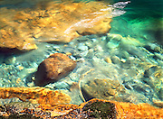 Abstract image of riverocks and colors in Ohonepecoosh River, Mt. Rainier National Park, Washington State