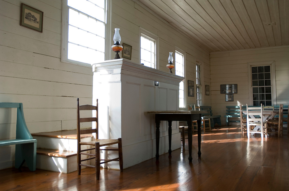 The interior of the first floor of the  Old Claiborne Masonic Temple. The first floor was used as a community hall. The podium was used by Marquis de Lafayette, when he visited Claiborne in 1825. The two-story building was restored by Claiborne resident Agee Broughton. Photo by Lori Waselchuk