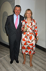 ARNAUD BAMBERGER and his wife CARLA at a dinner hosted by Arnaud Bamber MD of Cartier, Amanda Sharp and Matthew Slotover Directors of the Frieze Art Fair to celebrate artists featured in the 2005 Frieze Art Fair Curatorial Programme at Nobu-Berkeley, 15th Berkeley Street, London on 21st October 2005.<br />