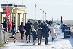 © Licensed to London News Pictures 13/02/2021.        Southend, UK. People walking along the seafront near Chalkwell Beach in freezing cold windy weather condition in Southend-on-Sea, Essex. Photo credit:Grant Falvey/LNP