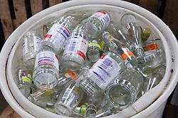 Bucket of glass jars at Ollerton recycling plant,