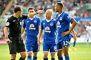 Everton's Steven Naismith (c) has words with the referee Stuart Atwell  late in the first half.<br /> Barclays Premier League match, Swansea city v Everton at the Liberty Stadium in Swansea, South Wales on Saturday 19th September 2015.<br /> pic by Phil Rees, Andrew Orchard sports photography.