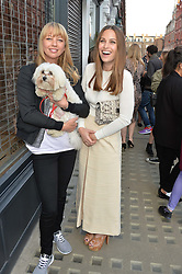 Left to right, SARA COX with her dog Beano and ANNA LAUB founder of Prism at the Prism Boutique Summer Party held at Prism, 54 Chiltern Street, London on 14th May 2014.