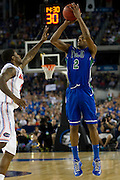 Bernard Thompson (2) of the Florida Gulf Coast University Eagles makes a three-pointer against the University of Florida Gators during the NCAA South Regionals at Cowboys Stadium in Arlington on Friday, March 29, 2013. (Cooper Neill/The Dallas Morning News)