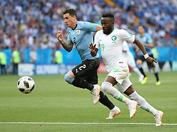 June 20, 2018 - Rostov-on-Don, Russia - FAHAD ALMUWALLAD (R) of Saudi Arabia vies with JOSE GIMENEZ of Uruguay during a Group A match between Uruguay and Saudi Arabia at the 2018 FIFA World Cup. (Credit Image: © Li Ming/Xinhua via ZUMA Wire)