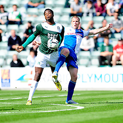 Plymouth Argyle's Neal Trotman jostles for the ball with Bristol Rovers' David Clarkson  - Photo mandatory by-line: Dougie Allward/JMP - Tel: Mobile: 07966 386802 07/09/2013 - SPORT - FOOTBALL -  Home Park - Plymouth - Plymouth Argyle V Bristol Rovers - Sky Bet League Two