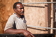 30 OCTOBER 2010 - PHOENIX, AZ: IBRAHIM SWARA-DAHAB at the Goat Meat Store, owned by Ibrahim Swara-Dahab, in Phoenix, AZ. Swara-Dahab came to the United States from Somalia in 1998. He has built a thriving business as a Halal butcher and provides freshly butchered goats and sheep killed following the precepts of Muslim tradition. His business not only caters to Muslims in the Phoenix area but also to refugees and immigrants from Africa and Asia. His small butcher shop is on the Gila River Indian Reservation, about 100 yards from the Phoenix city limits and doesn't have either running water or electricity.    Photo by Jack Kurtz