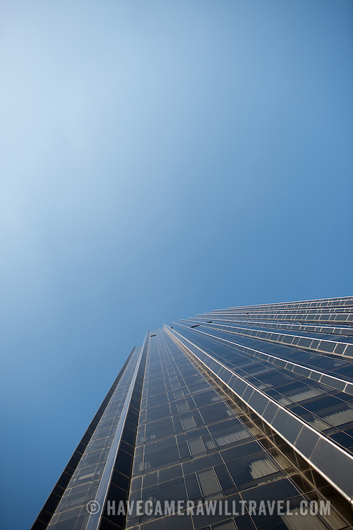 A skyscraper in midtown Manhattan towers up to a clear blue sky.