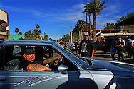 """Mark """"Elvis"""" Priestley, host of the Discovery Channel's Driving Wild, interacts with members of a Low Rider Club while filming  in Mexicali, Mexico on Saturday, November 7, 2015.(Photo by Sandy Huffaker/Getty Images for The Discovery Networks International)"""