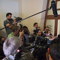 Tamas Gyarfas (C) vice-president of FINA swimming association talks to the media after a court ruling connected to his arrest in a murder case in Budapest, Hungary on April 20, 2018. ATTILA VOLGYI