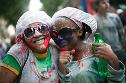© Licensed to London News Pictures. 28/08/2011. London, UK. Notting Hill Carnival, Europe's largest street carnival, kicks of with the traditional J'Ouvert parade, where participants throw paint, powder and flour over each other. Photo credit: Bettina Strenske/LNP