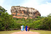 Sigiriya, or Lion's rock, is an ancient rock fortress and palace ruin surrounded by the remains of an extensive network of gardens, reservoirs, and other structures. A popular tourist destination, Sigiriya is also renowned for its ancient fresco paintings which are reminiscent of the Ajanta Caves of India.  Sigiriya was built during the reign of King Kassapa I and it is one of the seven World Heritage Sites of Sri Lanka.  The Sigiriya rock is a hardened magma plug from an extinct and long-eroded volcano. It stands high above the surrounding plain, visible for miles in all directions.