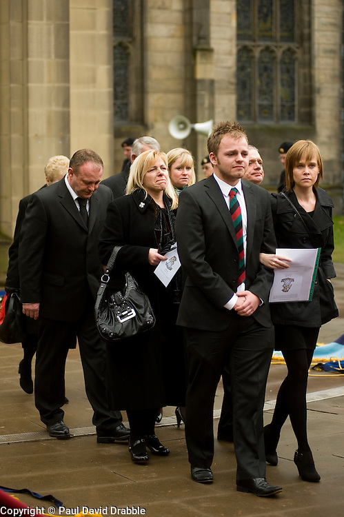 """Family including including his mother Cheryl Routlidge and Brother Jonathan Riley leave the funeral of  Corporal Liam Riley following the barer party made up of Soldiers from The Yorkshire Regiment carried Corporal Liam Rileys coffin out of Sheffield Cathedral where his Funeral service took place on Wednesday 24 February. ..Corporal Riley of 3rd Battalion Yorkshire Regiment who died in an explosion in Afghanistan on 1 February 2010 while on foot patrol south of the Kings Hill check point Helmand. ..Upon hearing of Liam's death he was described by Price Harry as """"a legend"""""""