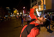 Jay Benham with the Pyrostura eats fire during a First Night celebration in downtown Tacoma. Client: The News Tribune