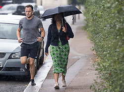 © Licensed to London News Pictures. 09/09/2021. Members of the public get caught in a downpour of rain at Regents Park in central London. Thunderstorms are expected across parts of the UK after a period of warm weather. Photo credit: Ben Cawthra/LNP