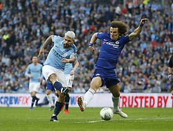BRITAIN-LONDON-FOOTBALL-CARABAO CUP FINAL-CHELSEA VS MAN London.(190224) -- LONDON, Feb. 24, 2019  Manchester City's Sergio Aguero (L) takes a shot past Chelsea's David Luiz during the Carabao Cup Final match between Chelsea and Manchester City at Wembley Stadium in London, Britain on Feb. 24, 2019. Manchester City won 4-3 on penalties after a 0-0 draw.  FOR EDITORIAL USE ONLY. NOT FOR SALE FOR MARKETING OR ADVERTISING CAMPAIGNS. NO USE WITH UNAUTHORIZED AUDIO, VIDEO, DATA, FIXTURE LISTS, CLUB/LEAGUE LOGOS OR ''LIVE'' SERVICES. ONLINE IN-MATCH USE LIMITED TO 45 IMAGES, NO VIDEO EMULATION. NO USE IN BETTING, GAMES OR SINGLE CLUB/LEAGUE/PLAYER PUBLICATIONS. (Credit Image: © Matthew Impey/Xinhua via ZUMA Wire)