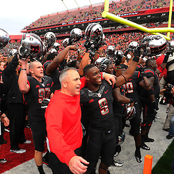 Oct 6, 2012: Rutgers Scarlet Knights head coach Kyle Flood and his team celebrate their victory in NCAA college football action between the Rutgers Scarlet Knights and UConn Huskies at High Point Solutions Stadium in Piscataway, N.J.