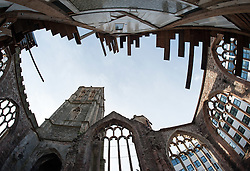 © Licensed to London News Pictures. 29/10/2015. Bristol, UK. Sanctum by THEASTER GATES.  The artist has built a performance space inside the ruins of a bombed out Temple Church, Temple Street, in central Bristol. The artist has sought out discarded and dormant materials from former places of labour and religious devotion across Bristol to build an intimate and distinctive temporary structure at Temple Church. From 6pm on Thursday 29th October, Sanctum will host a continuous programme of sound over 552 hours until Saturday 21st November, sustained by performers, musicians and bands, spoken word artists and the visiting casts of theatre productions in Bristol. Visitors will be able to enter Sanctum day and night, but the schedule will always remain secret. Visitors won't know who they are about to hear. Produced by international arts producers Situations, in partnership with English Heritage, Sanctum is the first public project in the UK by Chicago-based artist Theaster Gates and forms part of the cultural programme for Bristol 2015 European Green Capital supported by Arts Council England. Photo credit : Simon Chapman/LNP