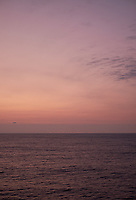 Pastel colored sky and clouds over the Pacific Ocean at dawn.  Image 12 of 21  for a panorama taken with a Fuji X-T1 camera and 35 mm f/1.4 lens  (ISO 400, 35 mm, f/2.8, 1/30 sec). Raw images processed with Capture One Pro and stitched together with AutoPano Giga Pro.